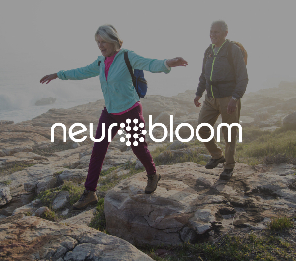 "A man and woman hiking with ""NeuroBloom"" overlaid."